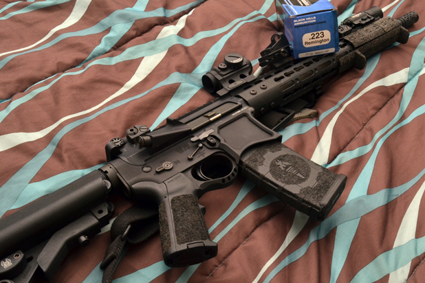 Cowan-AR15 for home defense clearing a home -authors rifle