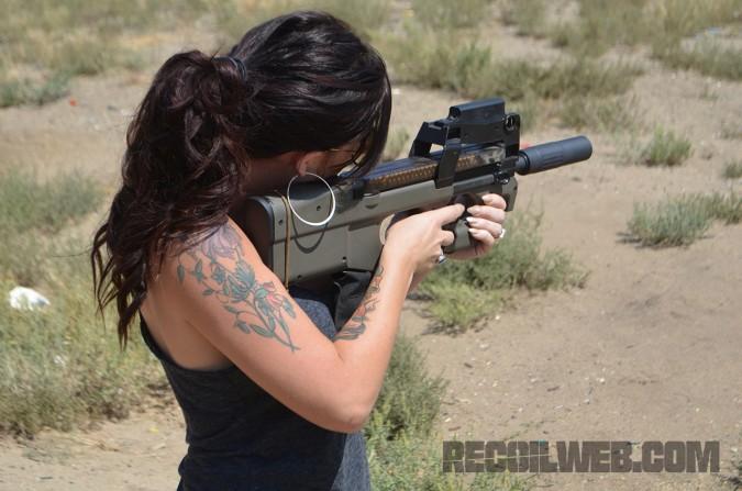 Karen fires the suppressed P90