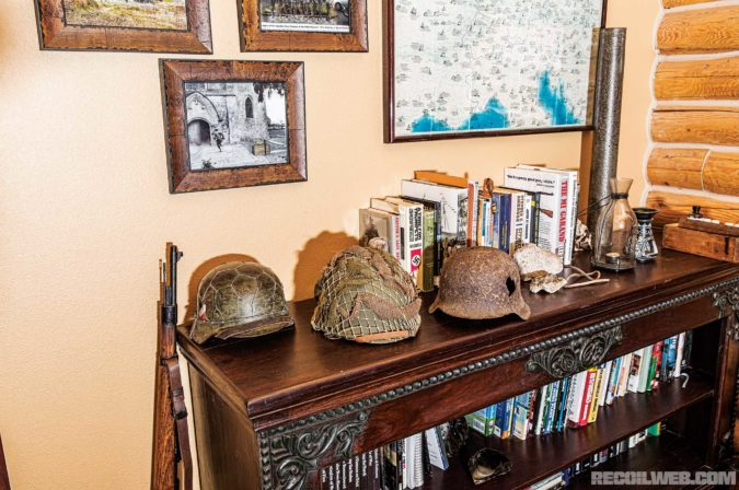 WWII collection includes a 1939 Mauser K98k with original Reichsadler insignia; American and German helmets, including a German helmet found near Bastogne with a hole in it, and a Panzer IV shell.