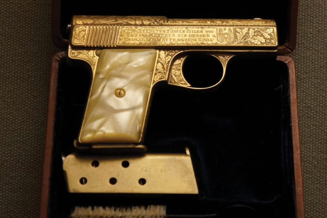 """3. This gold-plated .32-caliber pistol was a gift from early Nazi Party member Max Kehl to Adolf Hitler. It was inscribed on the reverse, """"In defiance of the Red Front and the Reaction, for the protection of our leader."""" Despite some reports, this wasn't the pistol the German dictator used to kill himself. Photo courtesy of West Point Museum Collection, United States Military Academy"""