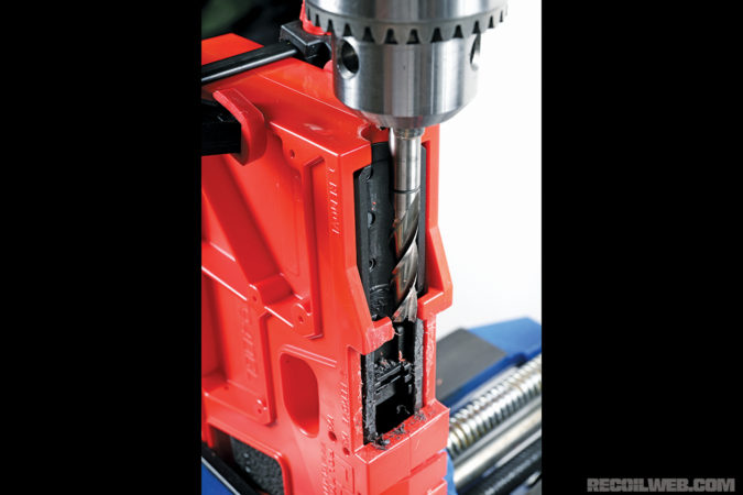 The end mill is used to remove tabs on the frame and cut a U-shaped area.
